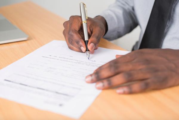 man-signing-mortgage-application
